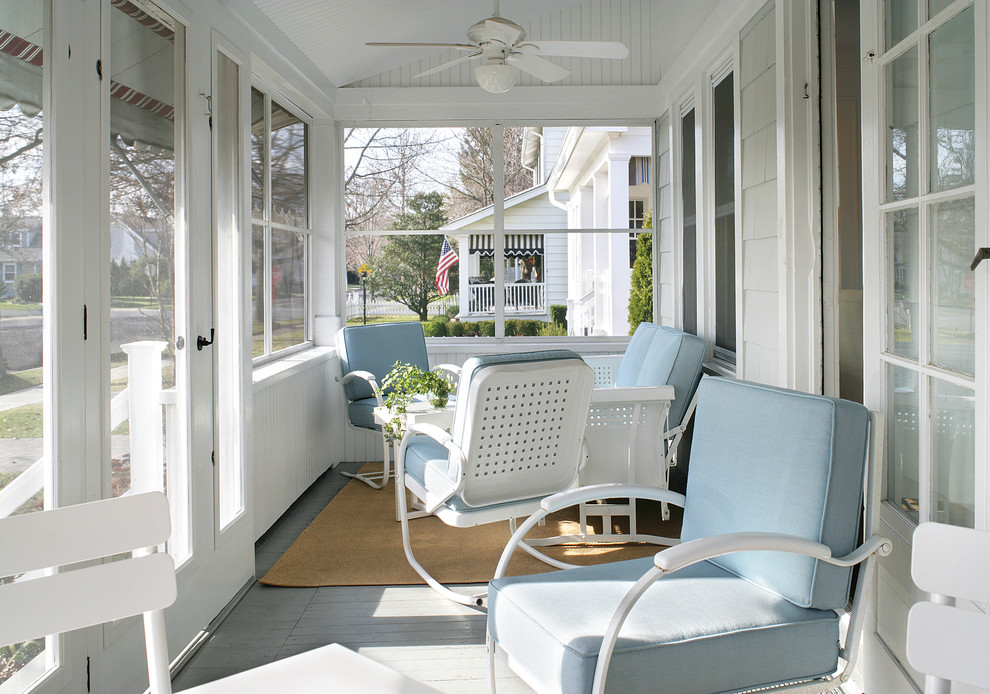Mid-sized beach style screened-in front porch idea in Newark with decking and a roof extension