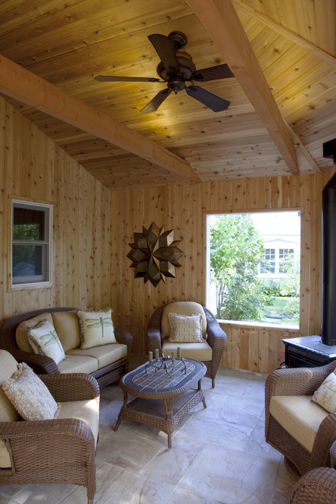This is an example of a traditional porch design in Milwaukee with a roof extension.