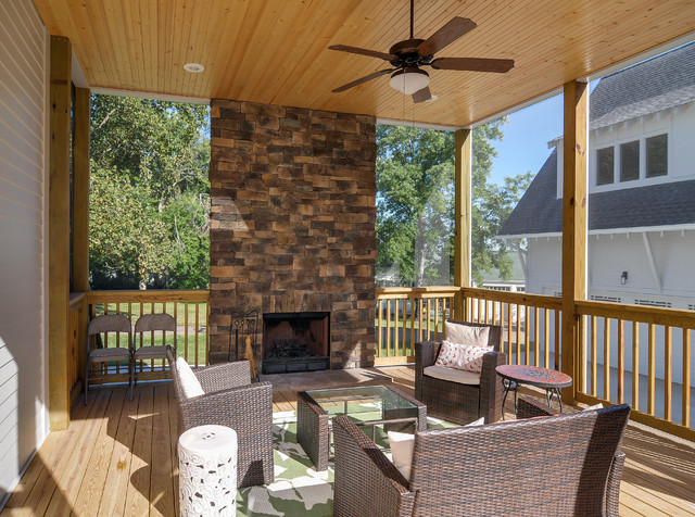 Screened Porch With Natural Stone Fireplace Traditional