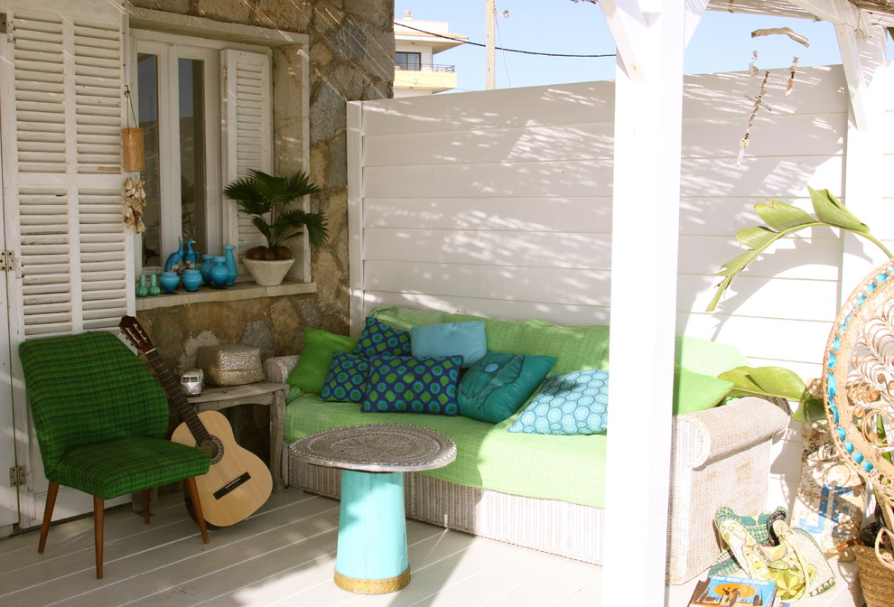Mid-sized beach style porch photo in Palma de Mallorca with decking