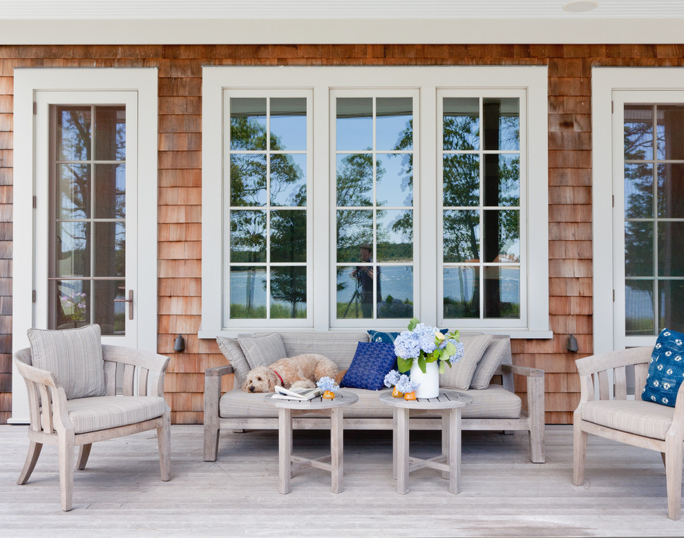 Beach style porch idea in New York with decking