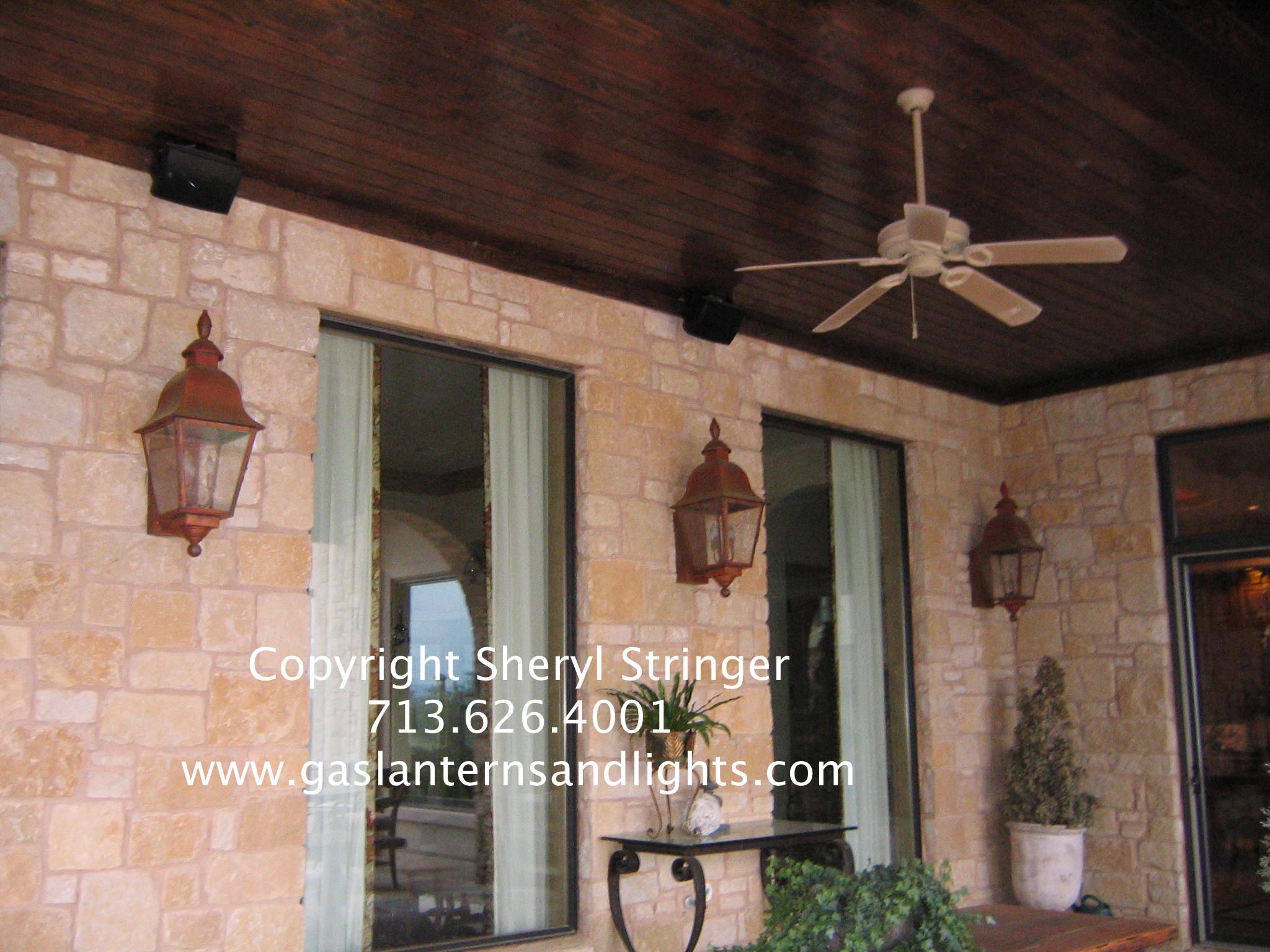 Sheryl's Electric Tuscan Lanterns on Porch