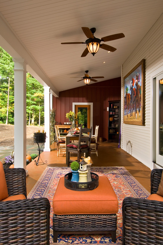 Cottage porch photo in New York with a roof extension