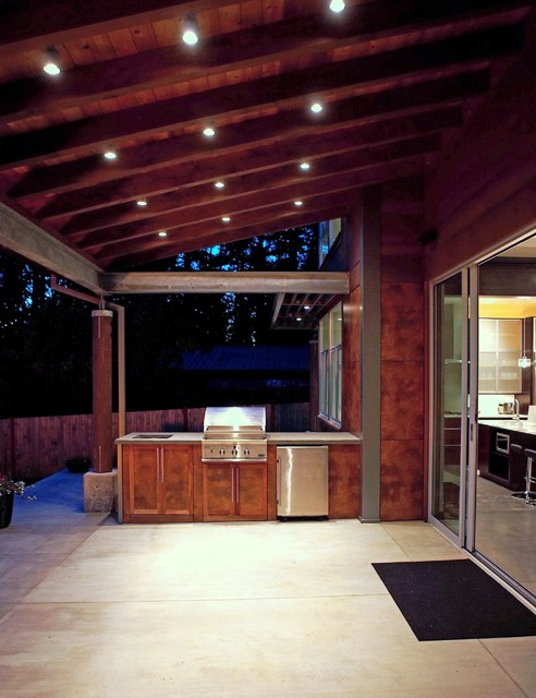 Outdoor cooking area at dusk. modern porch
