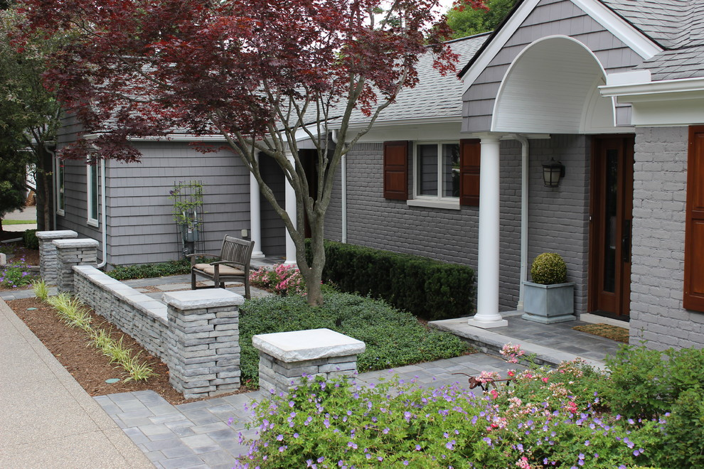 Inspiration for a small transitional stone front porch remodel in Detroit