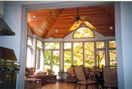 soaring wood ceilings over a large screen porch traditional-porch