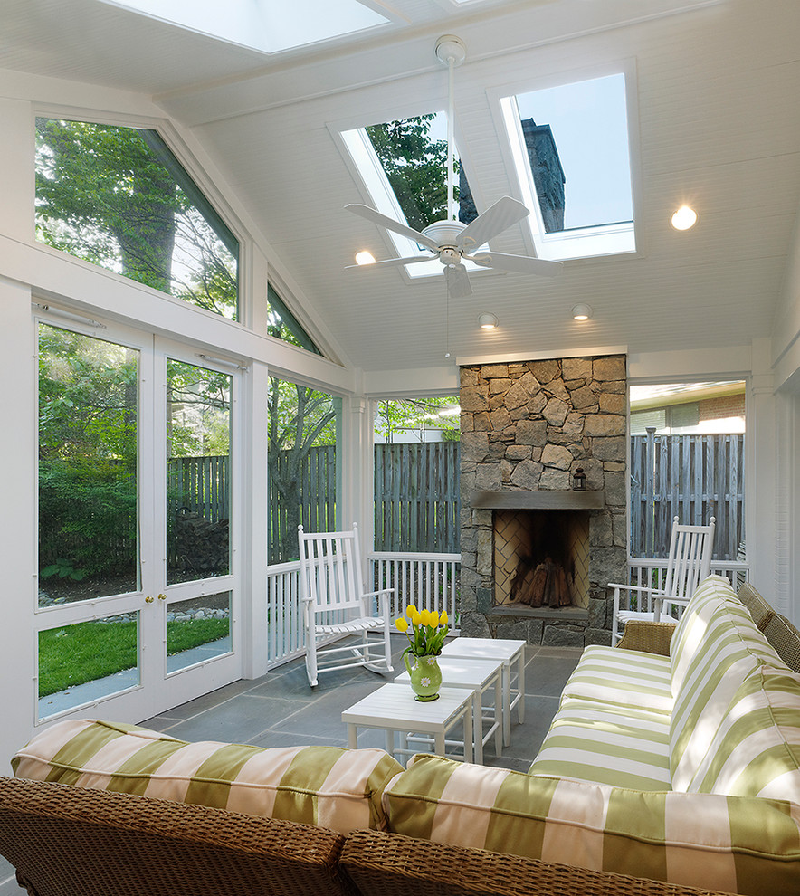 Elegant screened-in porch photo in DC Metro with a roof extension