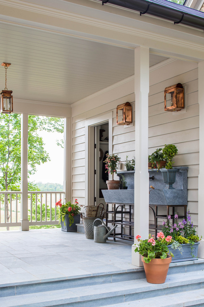 Mid-sized cottage stone porch photo in Richmond with a roof extension