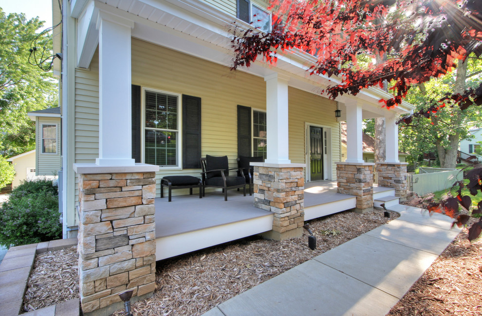 Mid-sized trendy concrete paver front porch photo in St Louis with a roof extension