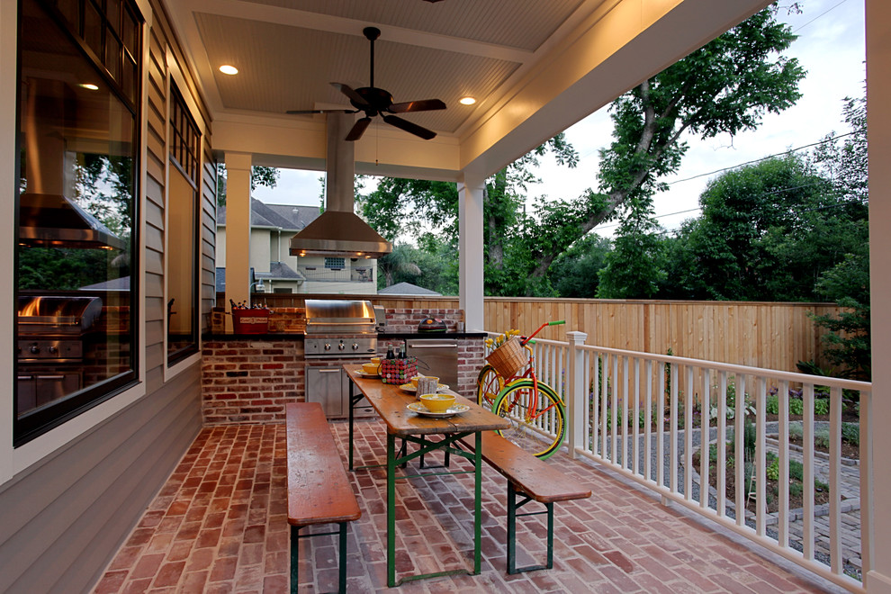Mid-sized classic brick porch idea in Houston with a roof extension