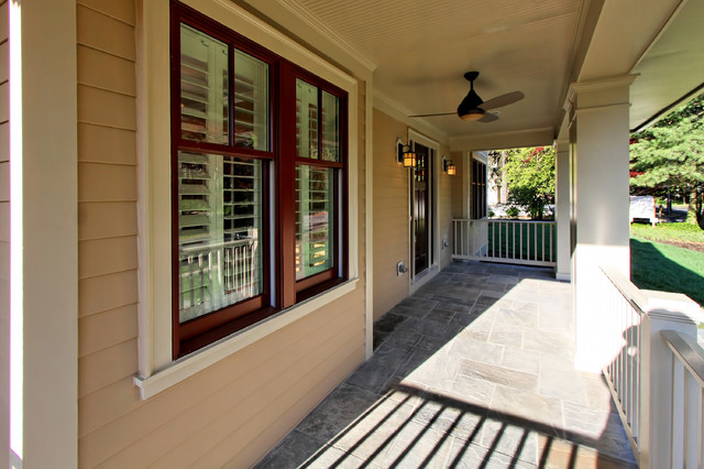 Stone Porch with ceiling fan traditional-porch