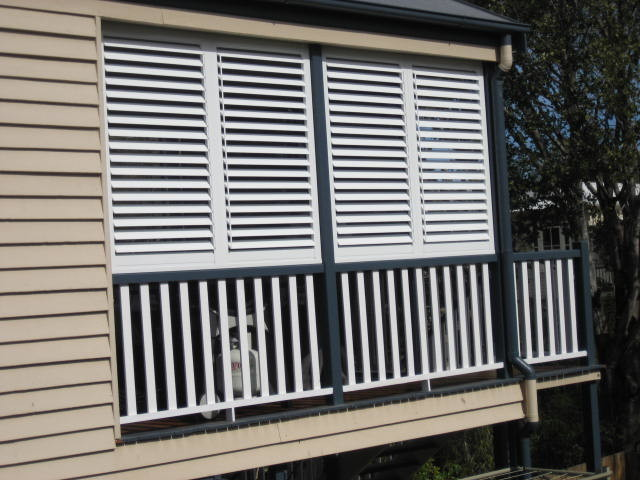 Stylish Privacy With Aluminum Shutters   Traditional   Porch ...