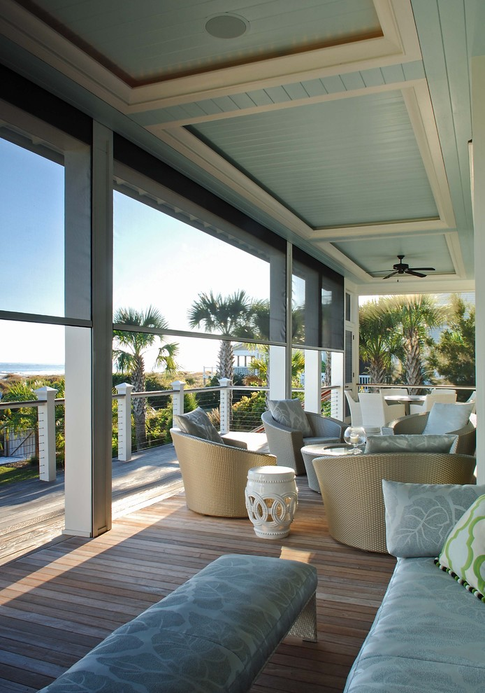 This is an example of a coastal porch design in Charleston with decking and a roof extension.