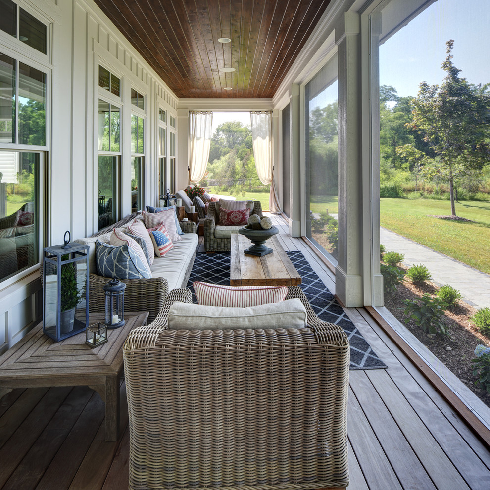 Farmhouse screened-in porch idea in Milwaukee with decking and a roof extension