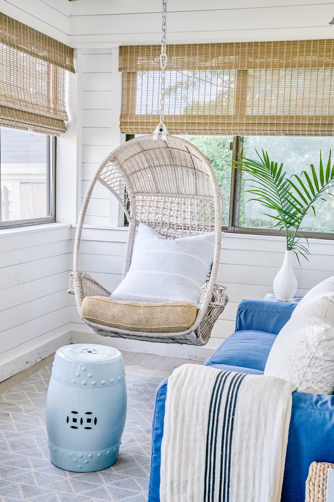 Small beach style screened-in porch idea in Providence with a roof extension