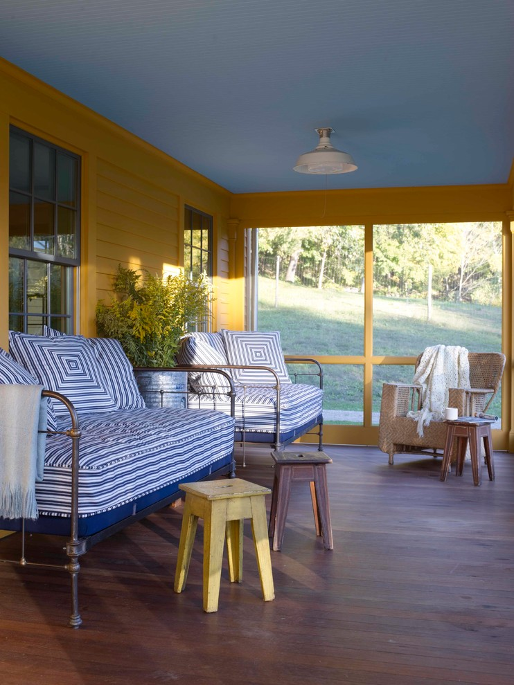 This is an example of a country porch design in New York.