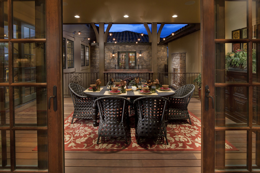 This is an example of a mediterranean porch design in Denver.