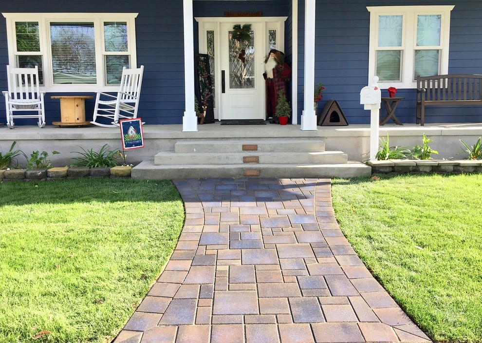 Mid-sized arts and crafts concrete paver front porch idea in Orange County with a roof extension