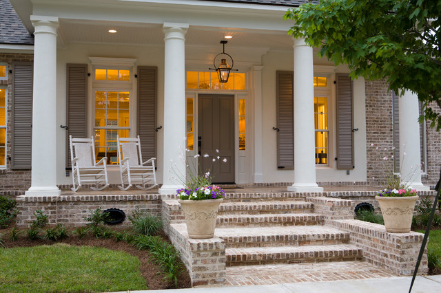 inspiration for a large timeless brick front porch remodel in new orleans with a roof extension - Porch Designs Ideas