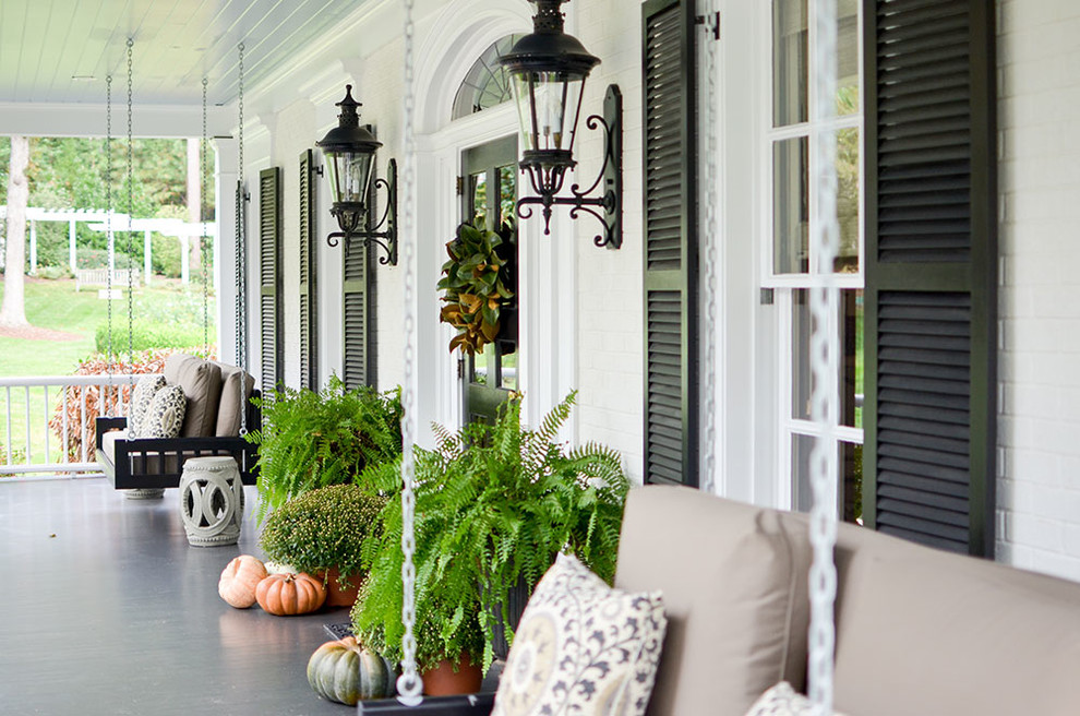 Inspiration for a timeless porch container garden remodel in Raleigh with a roof extension