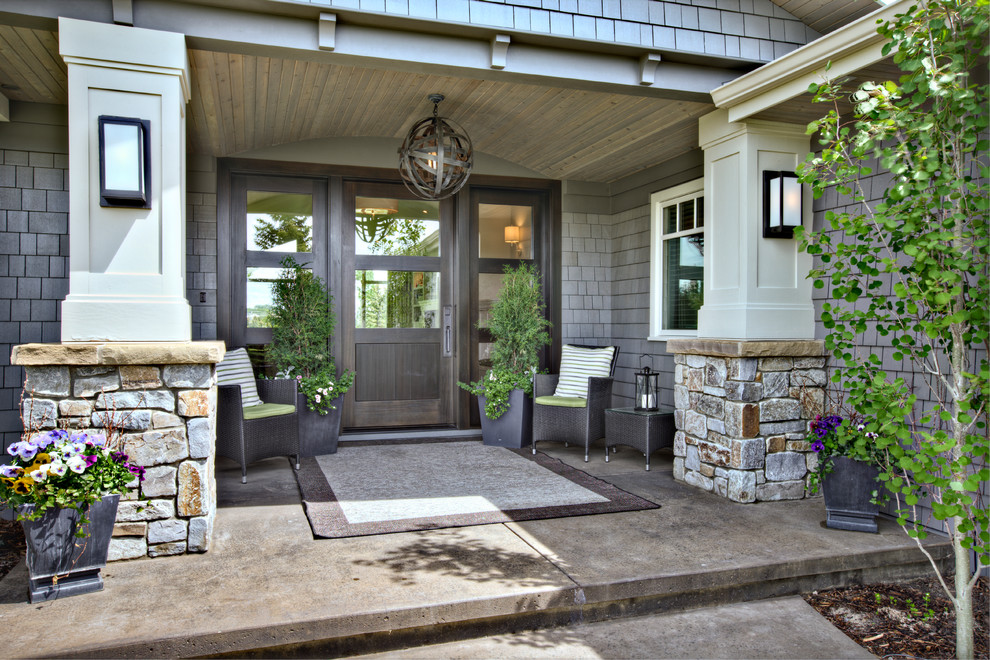 This is an example of a traditional concrete front porch design in Calgary.