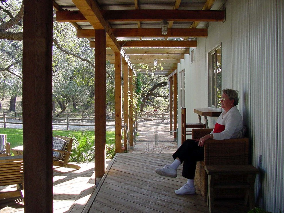 This is an example of an industrial porch design in Austin.