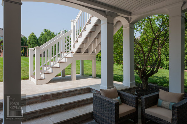 two story double porch with outdoor fireplace travertine For2 Story Decks And Patios