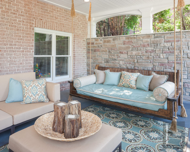 Two story double porch with outdoor fireplace, travertine patio, and AZEK deck contemporary-porch