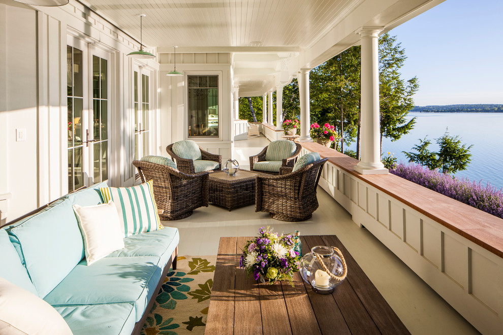 Mid-sized beach style back porch idea in Other with decking and a roof extension