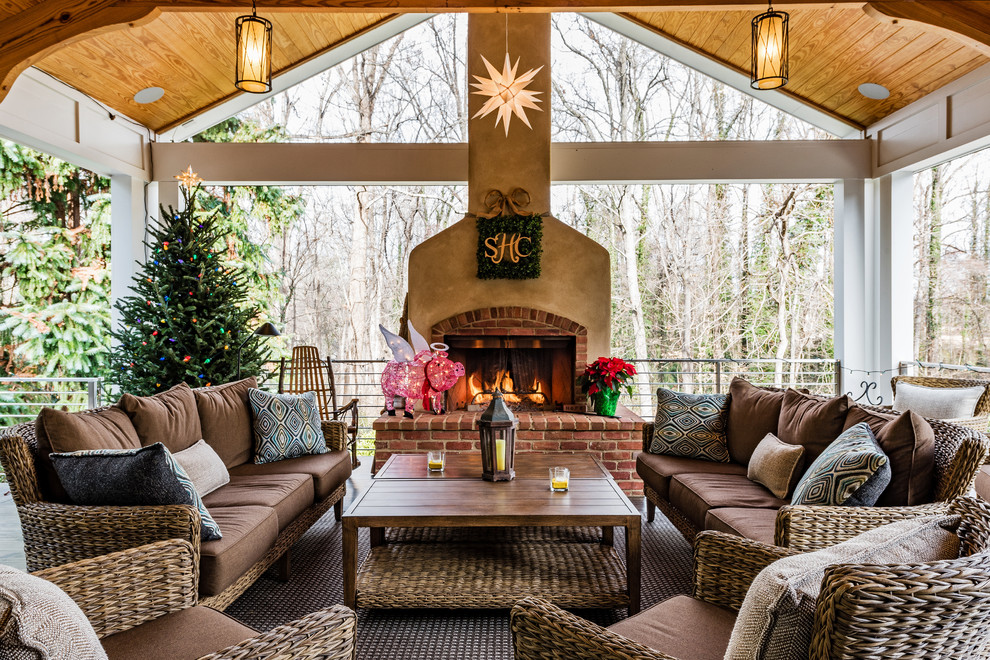 Classic porch idea in Other with a fireplace and a roof extension