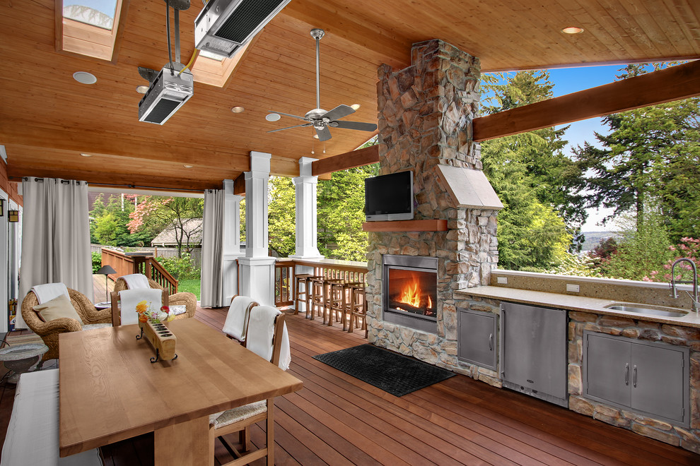 Elegant porch photo in Seattle with a fire pit