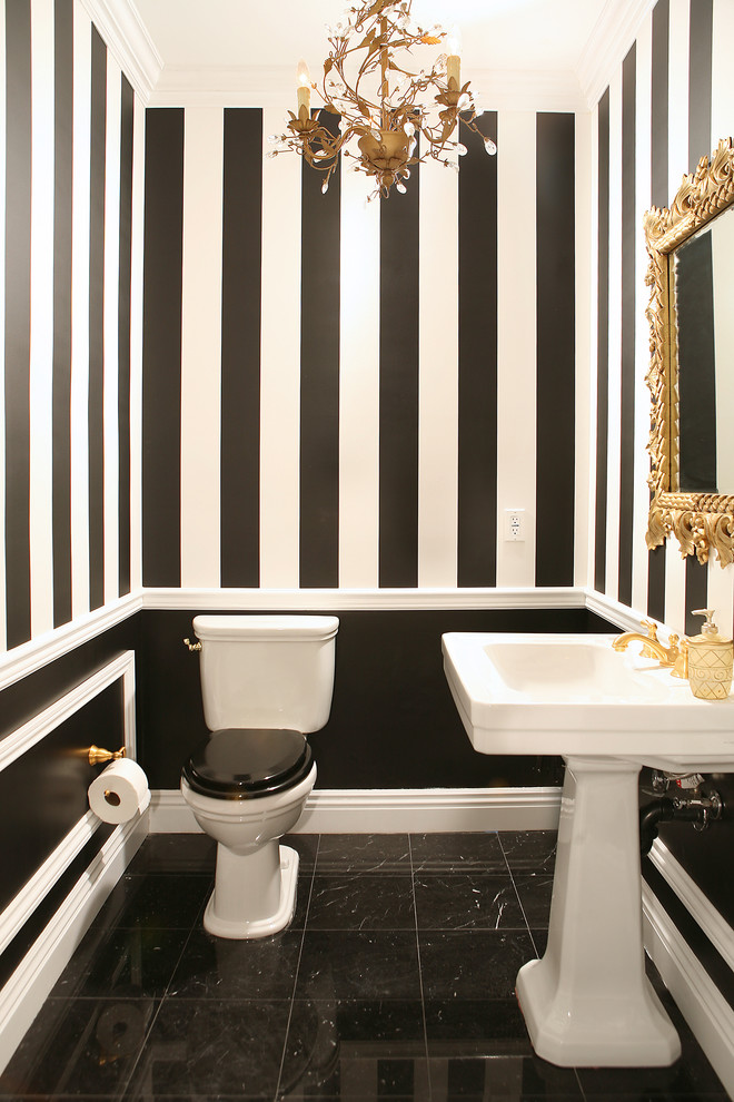 Example of a classic powder room design in Los Angeles with a pedestal sink