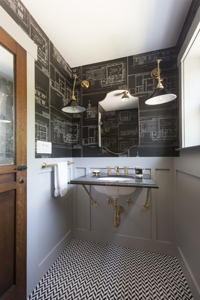Small transitional black tile, white tile and black and white tile mosaic tile floor powder room photo in San Francisco with marble countertops, gray walls and an undermount sink