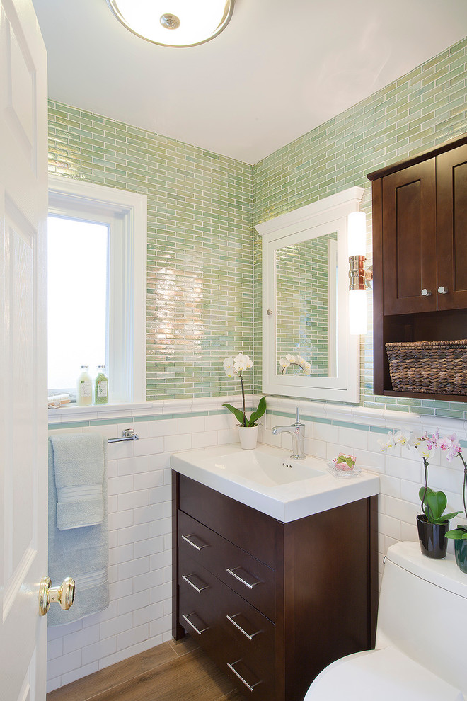 Example of a trendy glass tile, green tile and white tile powder room design in Los Angeles