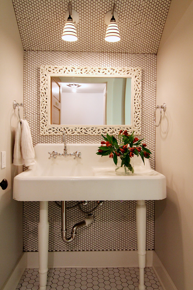 Elegant powder room photo in Other with a console sink and beige walls