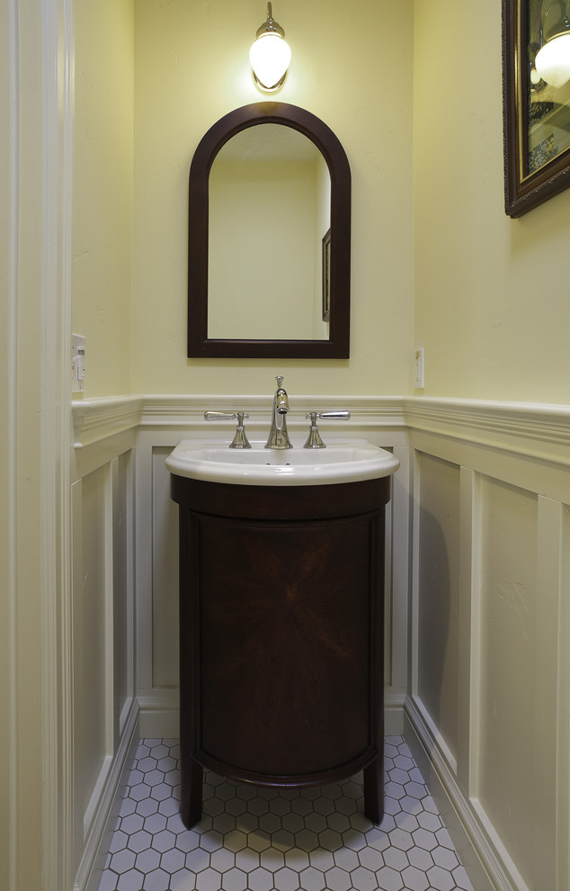 Inspiration for a craftsman powder room remodel in San Francisco with a drop-in sink, furniture-like cabinets and dark wood cabinets