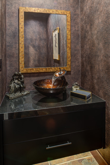 Powder room - small contemporary multicolored floor powder room idea in San Francisco with flat-panel cabinets, black cabinets, brown walls, a vessel sink and engineered quartz countertops
