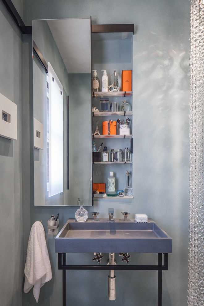 Example of a trendy powder room design in San Francisco with a console sink and gray walls