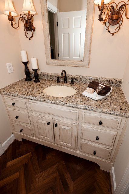 Antiqued vanity cabinet traditional powder room for Powder room cabinets vanities