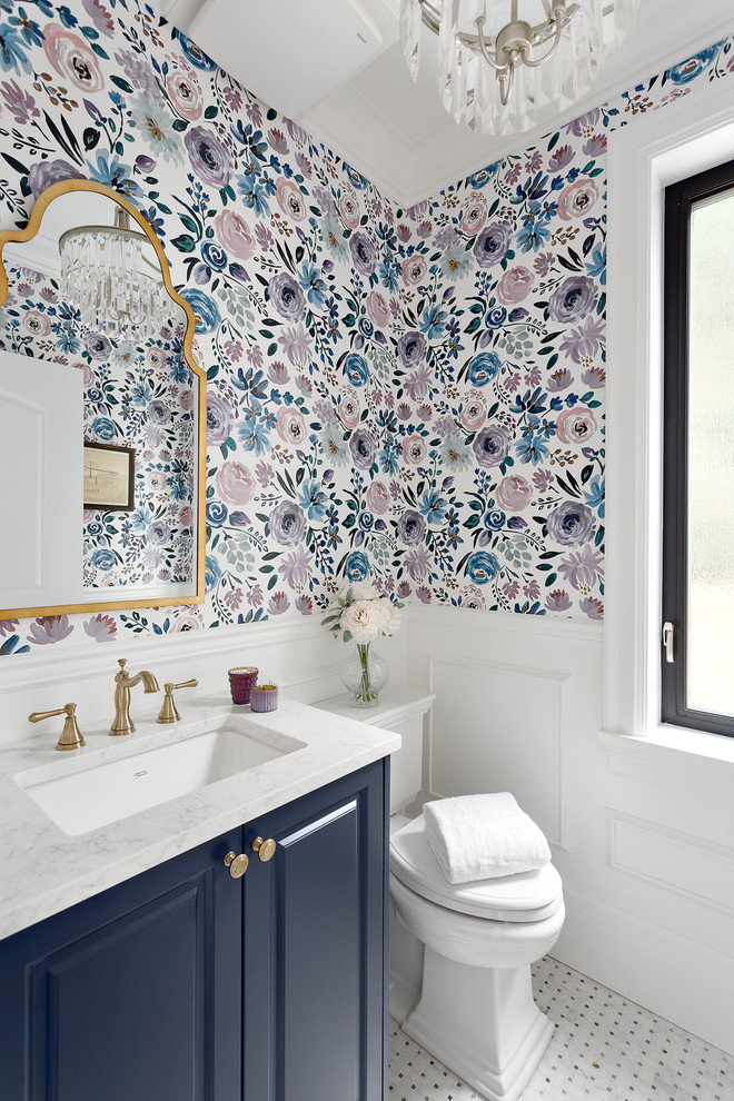 Inspiration for a small timeless mosaic tile floor and white floor powder room remodel in Vancouver with recessed-panel cabinets, blue cabinets, a two-piece toilet, an undermount sink, quartz countertops, white countertops and multicolored walls