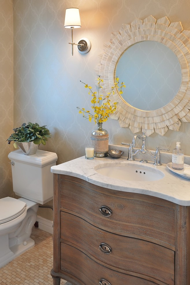 Example of a french country powder room design in Phoenix with an undermount sink, a two-piece toilet, furniture-like cabinets and dark wood cabinets