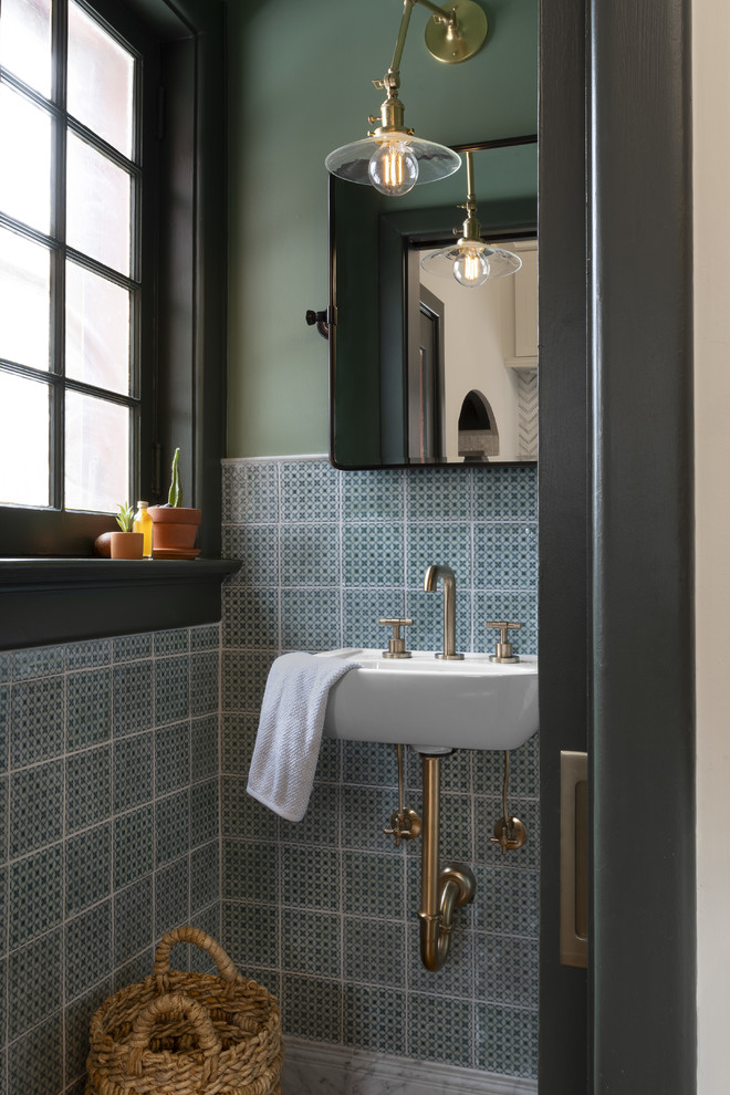 Inspiration for a small transitional green tile and ceramic tile powder room remodel in St Louis with green walls and a wall-mount sink