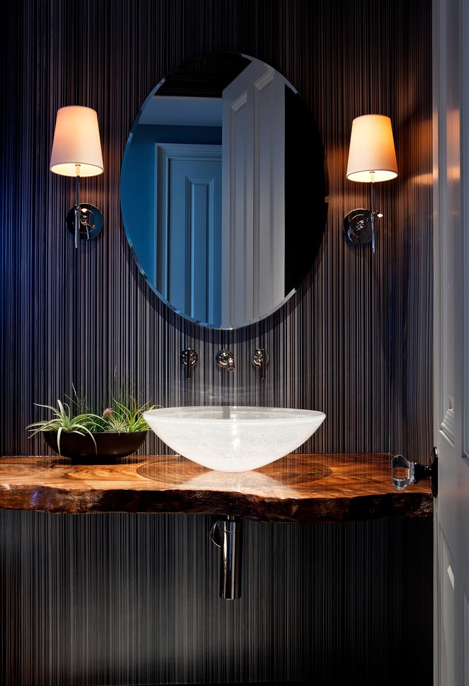 Inspiration for a tropical powder room remodel in San Francisco with a vessel sink, black walls and brown countertops