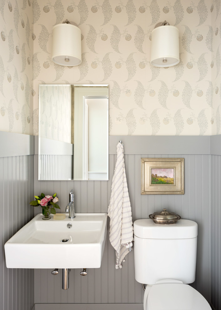 Example of a small classic powder room design in Other with a two-piece toilet, multicolored walls and a wall-mount sink