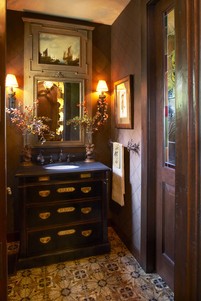 Inspiration for a timeless beige tile powder room remodel in Minneapolis with an undermount sink, furniture-like cabinets and blue countertops