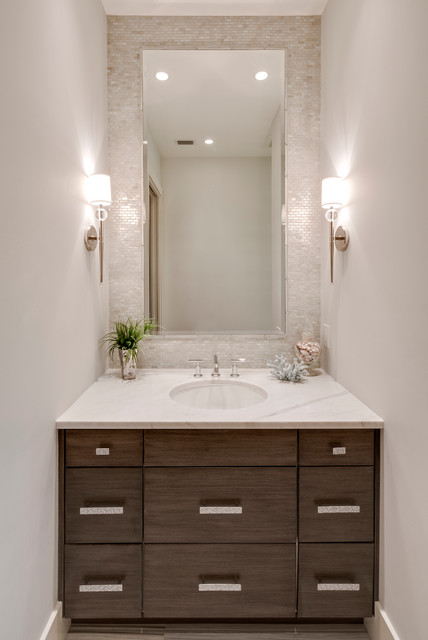 Powder room - transitional gray tile powder room idea in Miami with dark wood cabinets and white countertops