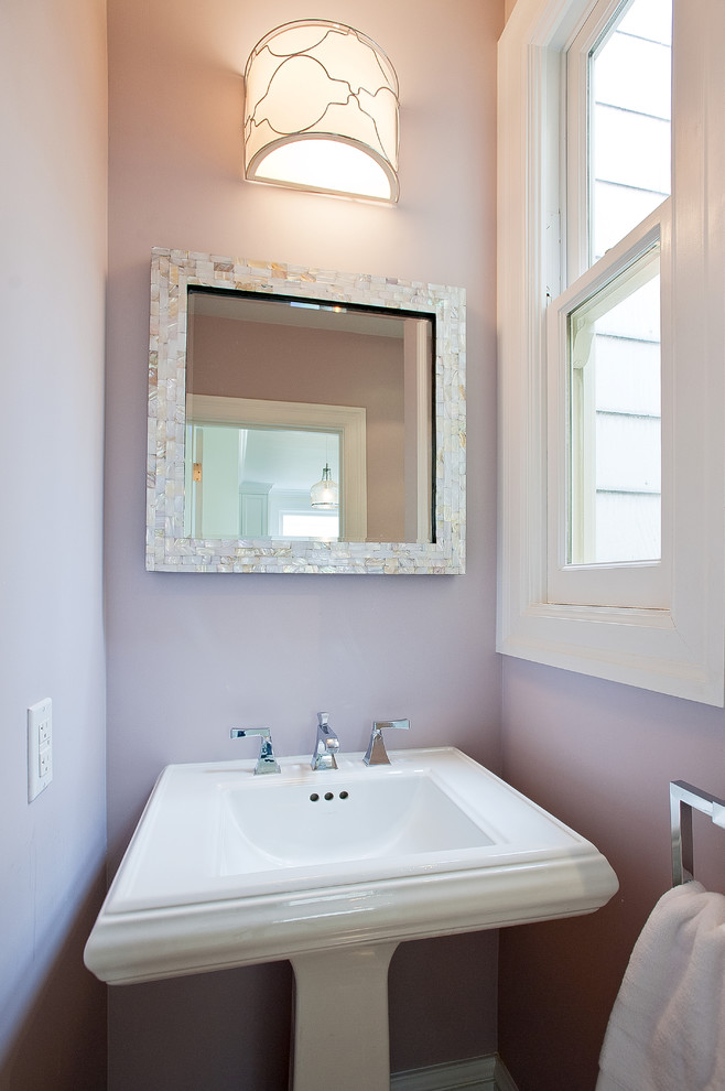 Example of a beach style powder room design in San Francisco with a pedestal sink