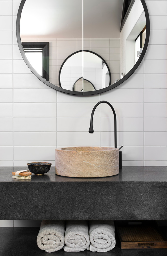 Photo of a contemporary powder room in Sydney with a vessel sink, white tile, subway tile and grey benchtops.