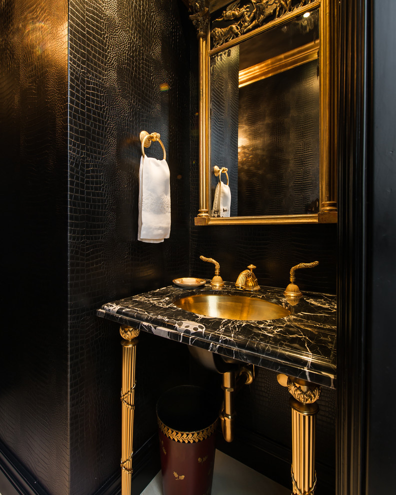Example of a classic powder room design in Los Angeles with a console sink and black walls