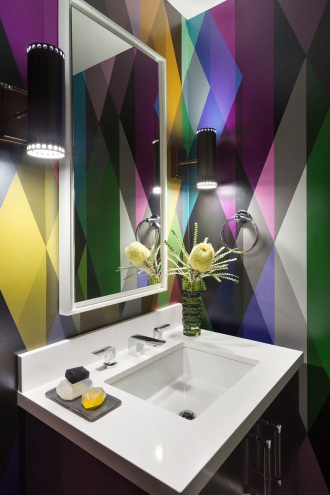 Small trendy powder room photo in San Francisco with multicolored walls, an undermount sink and white countertops